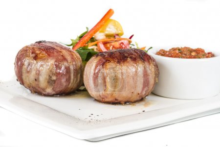 Grilled steak wrapped in bacon, with grilled vegetables, mashed