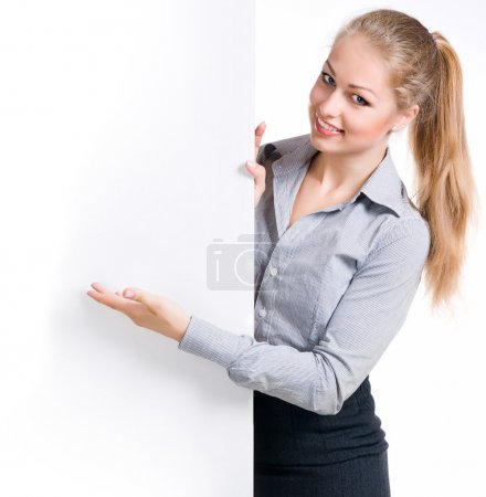 Photo for Businesswoman standing behind blank whits billboard. Isolated over white - Royalty Free Image