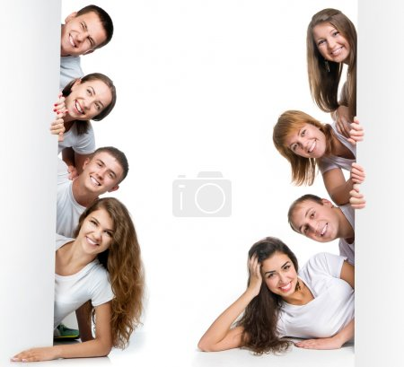Photo for Group of pretty young looking out white board. - Royalty Free Image