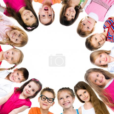 Photo for Group of smiling kids standing in huddle on white background - Royalty Free Image