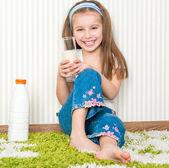 Little girl drink the milk