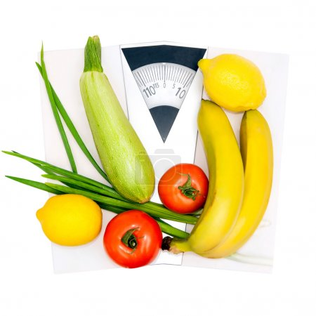 Photo for Diet and nutrition. Vegetables and fruits on the scales - Royalty Free Image