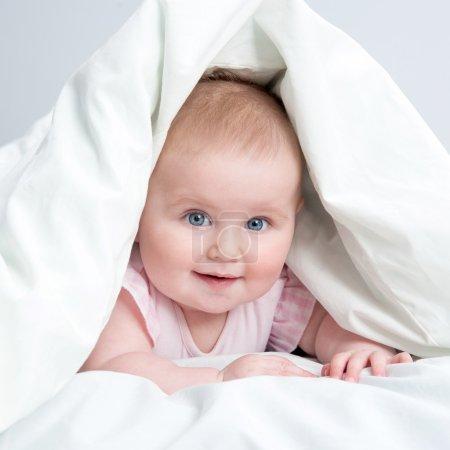 cute baby under a blanket