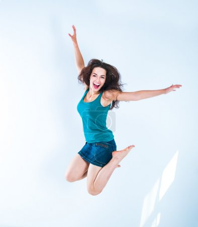 Photo for Beautiful jumping girl in a bright room - Royalty Free Image