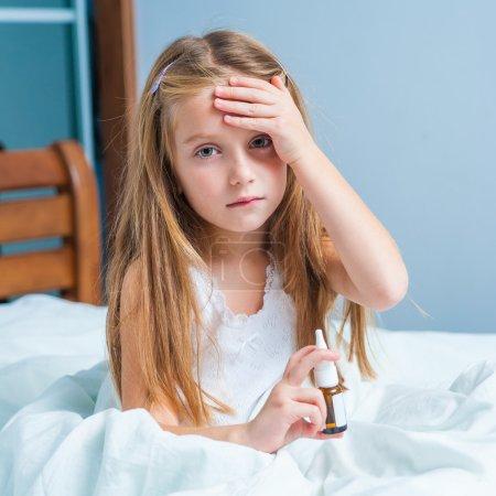 little girl in runny nos