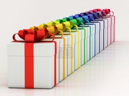 Photo pour Coffrets cadeaux blancs avec ruban de couleur varicole sur fond blanc - image libre de droit
