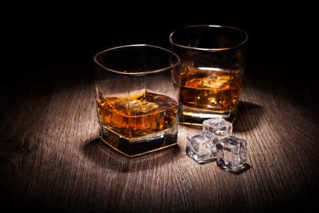 Photo for Whiskey in glass on wooden table - Royalty Free Image