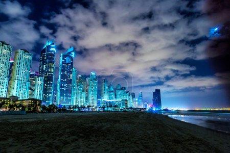 Photo for DUBAI, UAE - NOVEMBER 13: Dubai downtown night scene with city lights, luxury new high tech town in middle East, United Arab Emirates architecture. Dubai Marina cityscape, UAE - Royalty Free Image