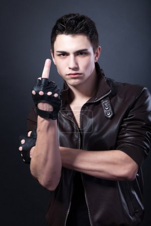 Young man is showing a middle finger