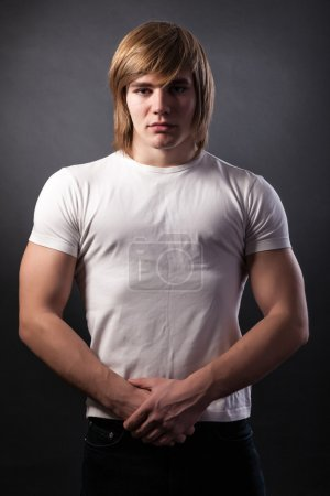Muscular young man in a white t-shirt