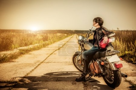 Photo for Biker girl sits on a motorcycle - Royalty Free Image