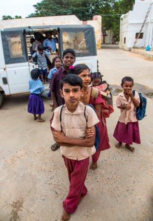 THANJAVUR, INDIA - FEBRUARY 14: School children get off the bus