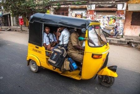 THANJAVUR, INDIA - FEBRUARY 13: Children go to school by auto ri