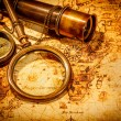 Vintage magnifying glass, compass, telescope and a...