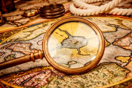 Vintage magnifying glass lies on the ancient map of the North Po