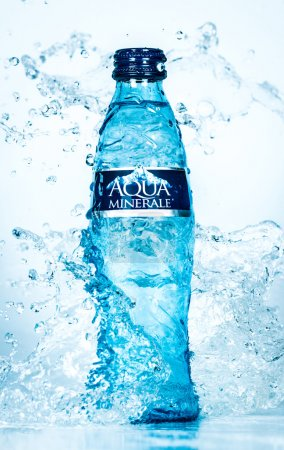 Bottle Aqua Minerale of water splash