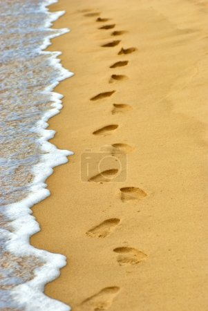 Human footprints on sand at the beach