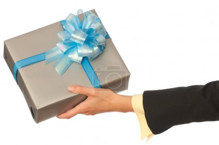 Photo for Woman giving a silver box with blue bow as a gift - Royalty Free Image