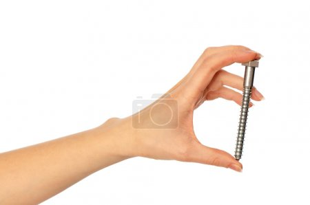Photo for Woman holding big bolt in the hand - Royalty Free Image