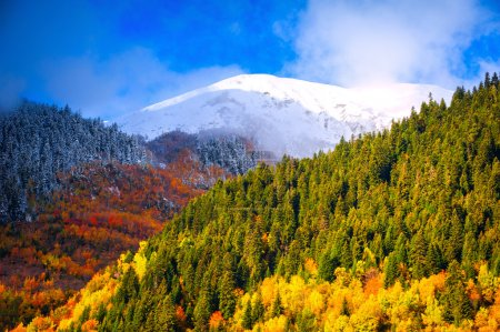 Mountain Landscapes. Meeting of the autumn and winter