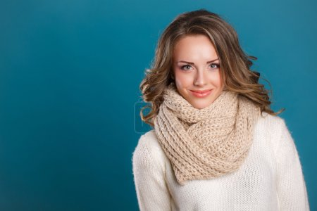 Girl in sweater and scarf