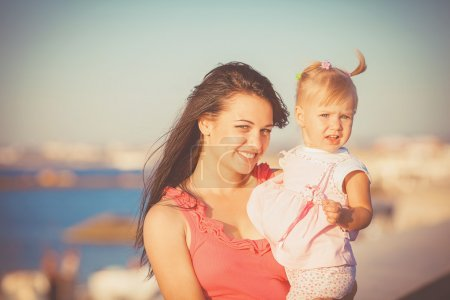 Photo for Happy mother and her little daughter in the summer day - Royalty Free Image