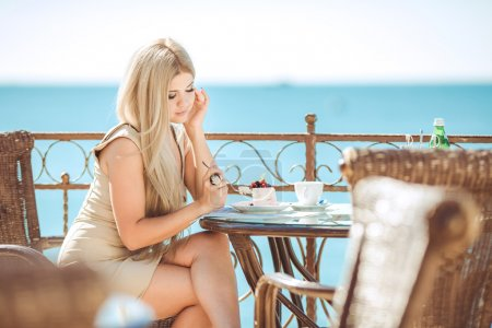 Young woman relaxing in an outdoor cafe