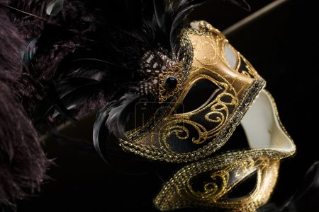 The Venetian masks with ornament over black background
