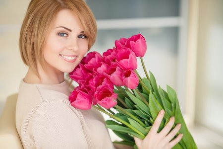 Bright pink flowers in girl's hands.