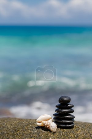 Photo for Zen stones pyramid on sand beach, meditation, concentration, relaxation, harmony, balance, ocean in pure simplicity. Japanese stone pyramid. finding solutions with zen mindset. zen stones jy garden - Royalty Free Image