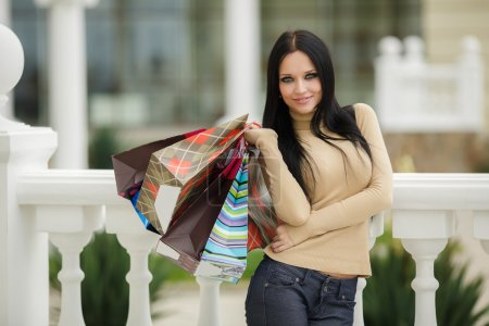 Happy woman with shopping bags. She enjoys the gifts and holidays