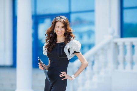 Photo for Successful woman holding digital tablet. Businesswoman using internet device and smiling. Professional success concept. - Royalty Free Image