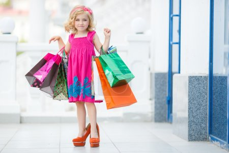 Little girl fashion with packages at the Mall