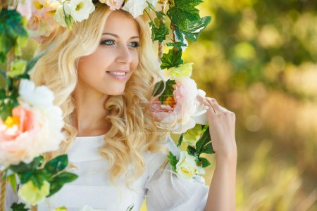 Beautiful woman with a wreath of flowers.