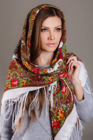 Photo for Beautiful oriental look. portrait of a beautiful young woman with a scarf on her head. Russian beauty. Russian national traditional scarf on head. - Royalty Free Image