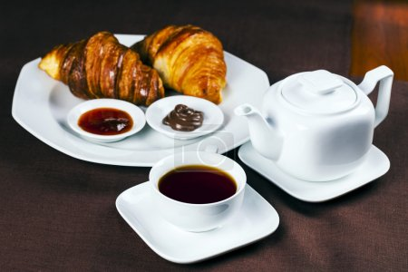 Photo for Tasty breakfast with croissants and tea - Royalty Free Image