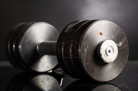 Photo for Metal barbell on dark gray background - Royalty Free Image