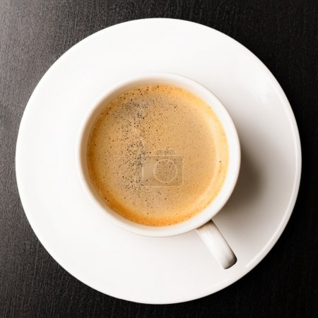 Photo for Cup of fresh espresso on table, view from above - Royalty Free Image