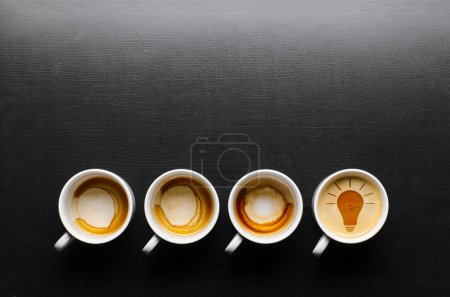 Photo for Idea. empty and full cups of fresh espresso with bulb sign, view from above - Royalty Free Image