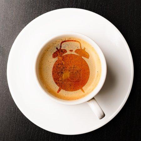alarm on cup of fresh espresso