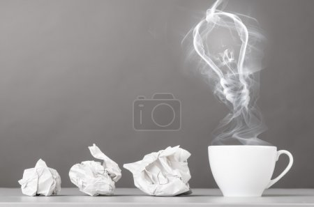 Photo for Idea birth. crumpled wads and bulb silhouette on gray - Royalty Free Image
