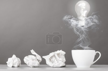 Photo for Creative process. crumpled wads and cup on gray - Royalty Free Image