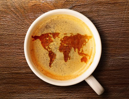 Photo for World map on cup of fresh espresso on table, view from above - Royalty Free Image