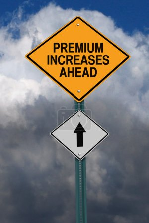Photo for Premium increases ahead road sign over dark blue sky with clouds - Royalty Free Image