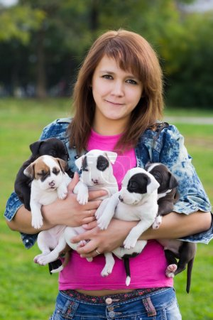 Young Women Holding Five Little Puppies American S...