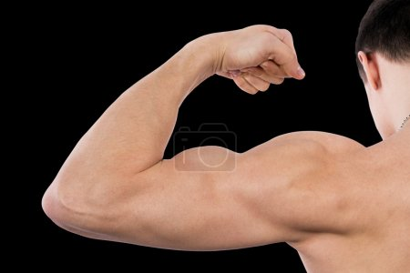Flexing biceps isolated on black