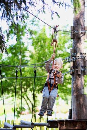 Little boy ziplining