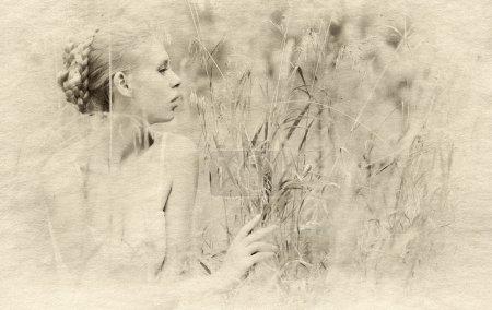 beautiful blond girl in the field