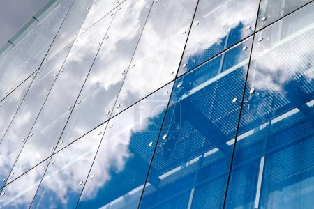 Photo for Cloud reflection on glass building - Royalty Free Image