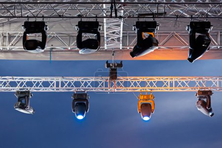 Photo for Lighting equipment with spotlights and floodlights under roof - Royalty Free Image